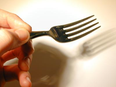holding a fork