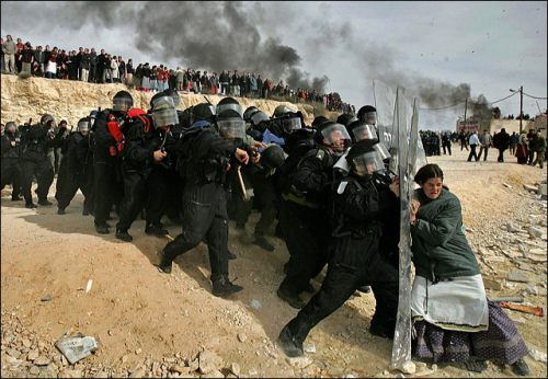 "A Jewish settler struggles with an Israeli security officer during clashes that erupted as authorities evacuated the West Bank settlement outpost of Amona, east of the Palestinian town of Ramallah. ltyde ""The Power of One"""